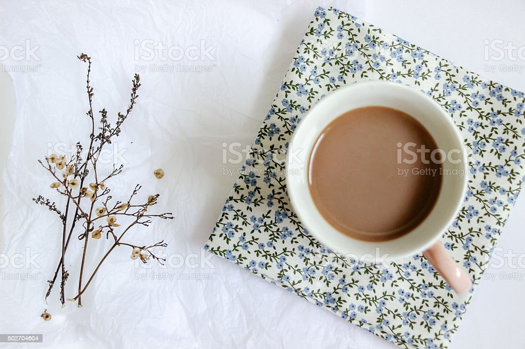 flower with a cup of milk tea stock photo