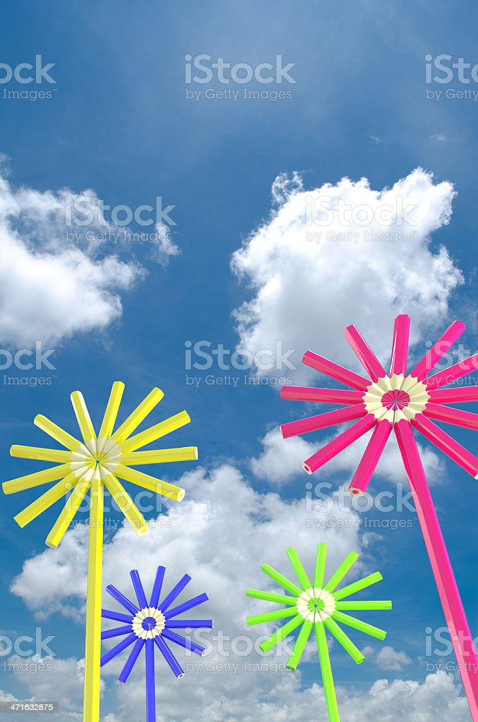 flower with pencils on blue sky  background royalty-free stock photo