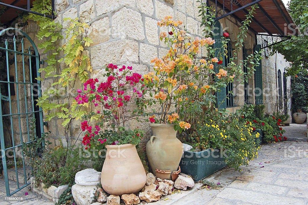 Flowerbed on medieval street of Jerusalem royalty-free stock photo