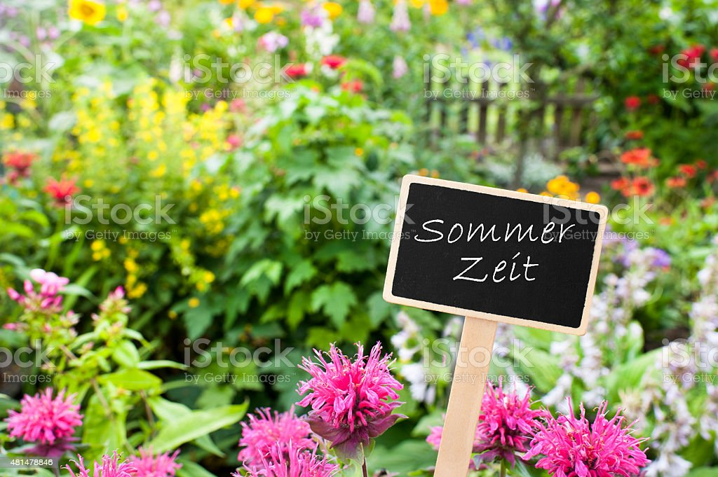 Flowerbed - Shield - daylight saving time stock photo