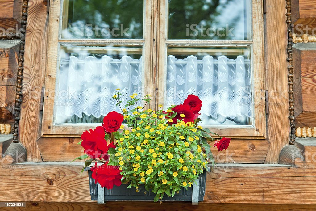 Flowerbox and Wooden House Poland stock photo