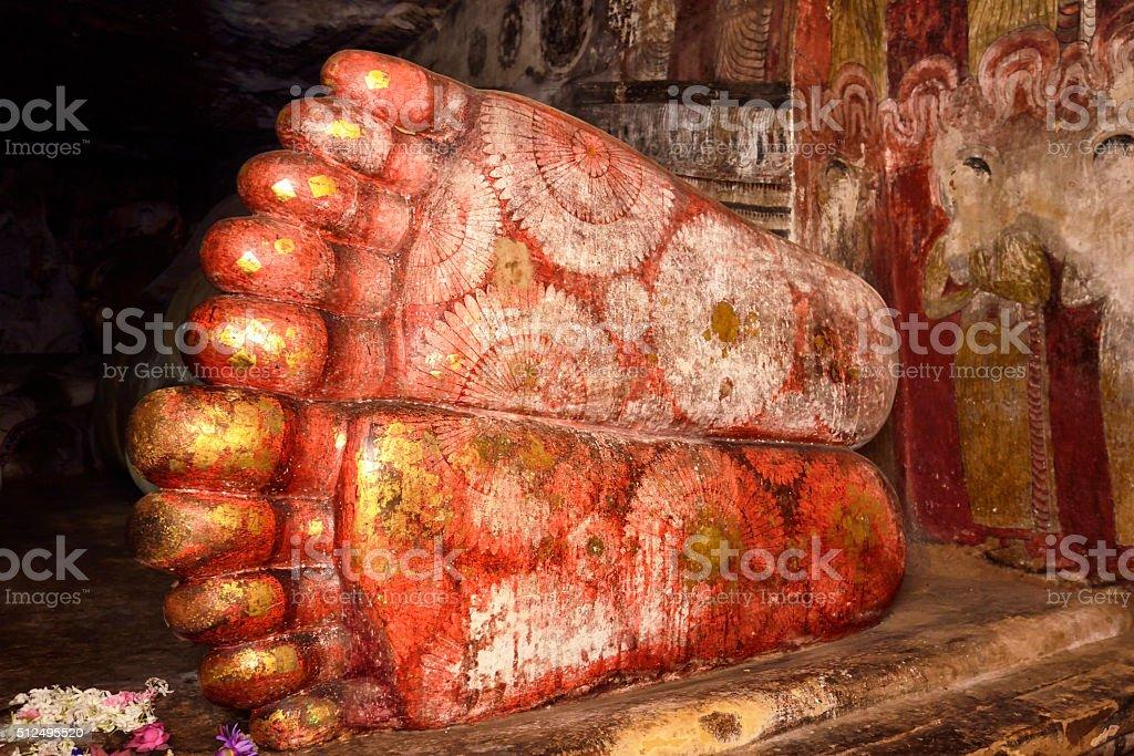 Flowered feet of Buddha in Dambulla Cave Temple, Sri Lanka stock photo