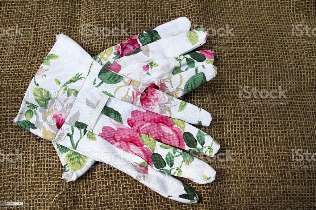 Flowered Gardening gloves stock photo