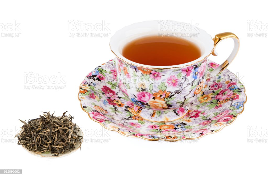 Flowered Tea Cup with Black Tea and Isolated on a White background with Deep Sharp Focus stock photo