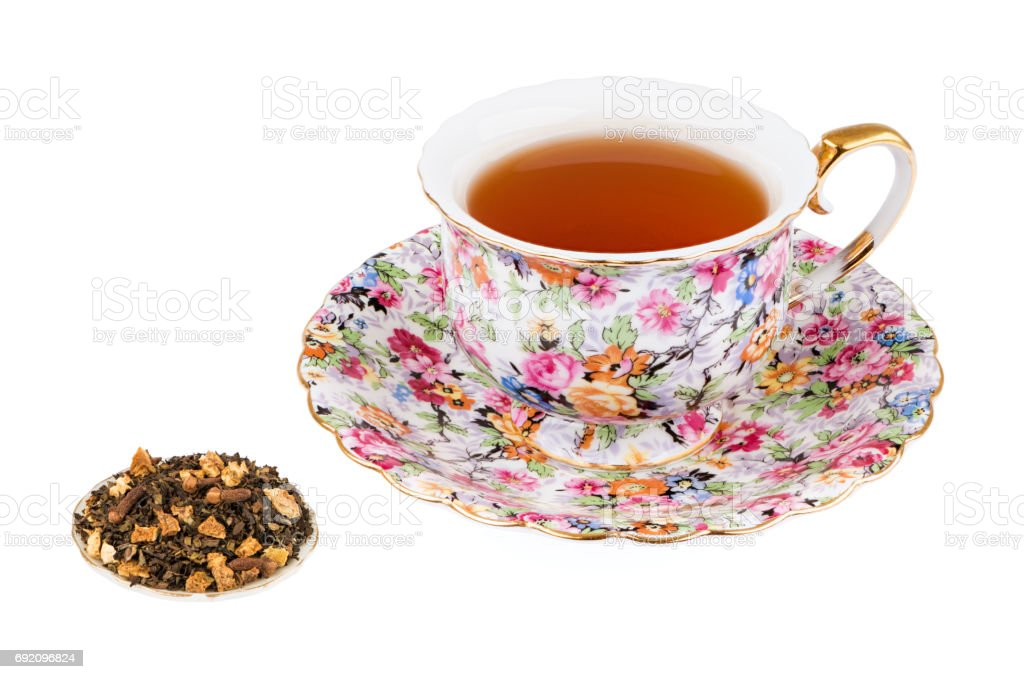 Flowered Tea Cup with Flavored Tea and Isolated on a White background with Deep Sharp Focus stock photo