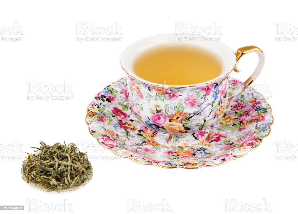 Flowered Tea Cup with White Tea and Isolated on a White background with Deep Sharp Focus stock photo