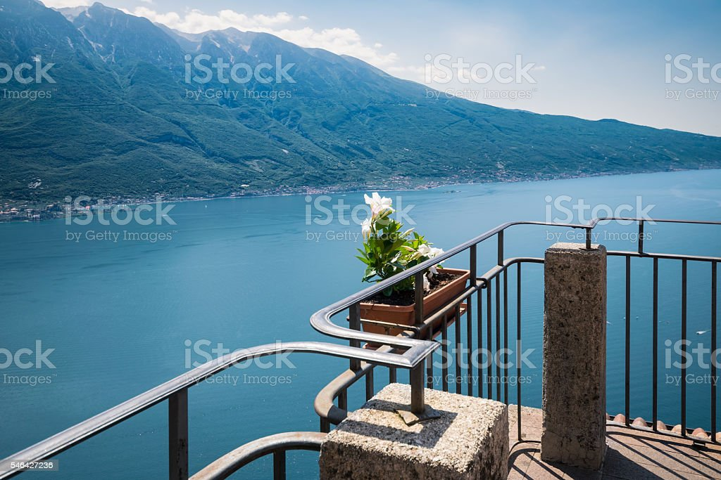 Flowered terrace overlooking Lake Garda. stock photo