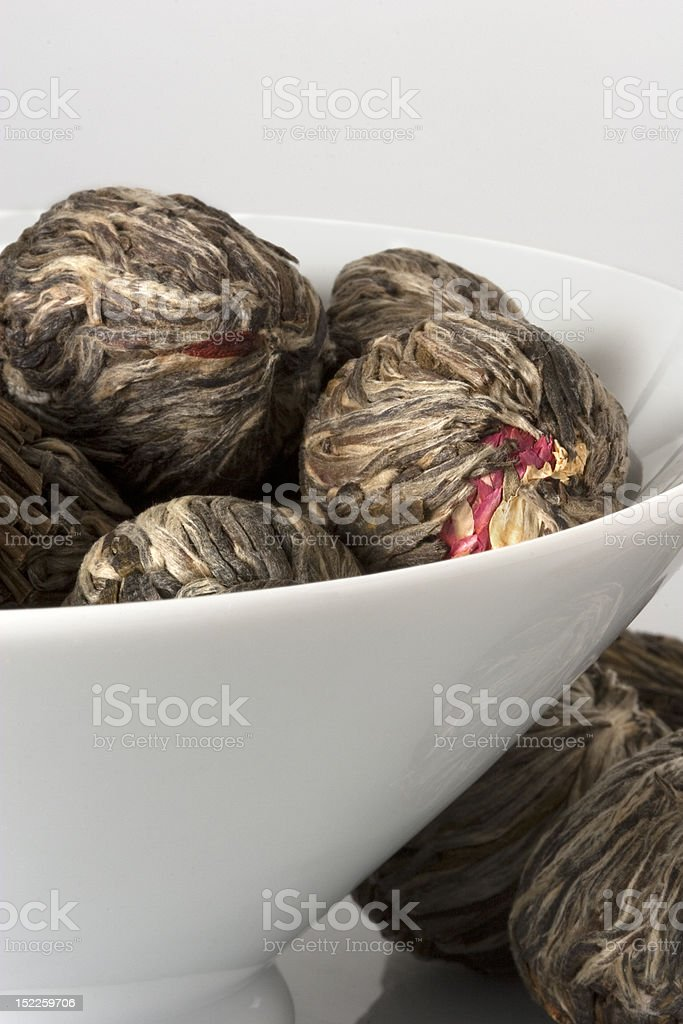 Flowering tea buds in white dish royalty-free stock photo