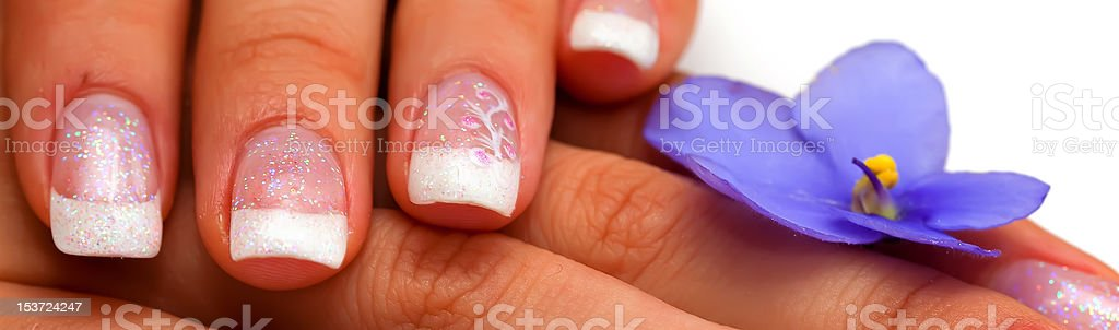 flower,nails and woman fingers royalty-free stock photo