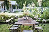 Flowerpot on table in garden