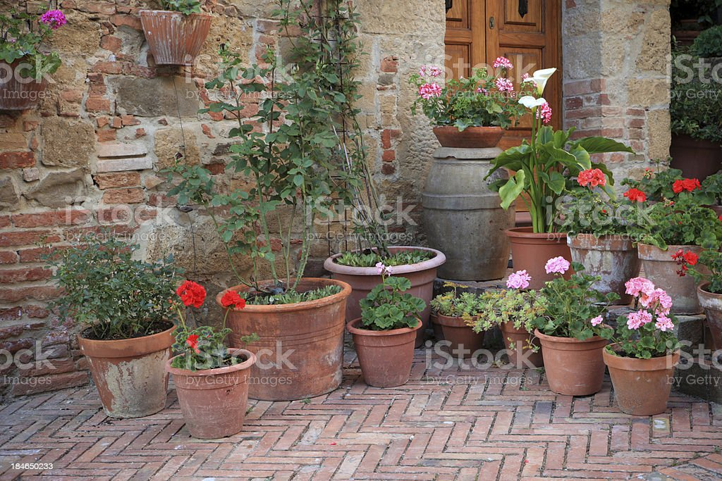 Flowerpots in a village. Val d'Orcia- Tuscany Italy royalty-free stock photo