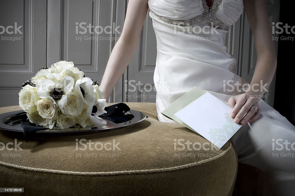 Flowers, a wedding dress and blank stationary. stock photo