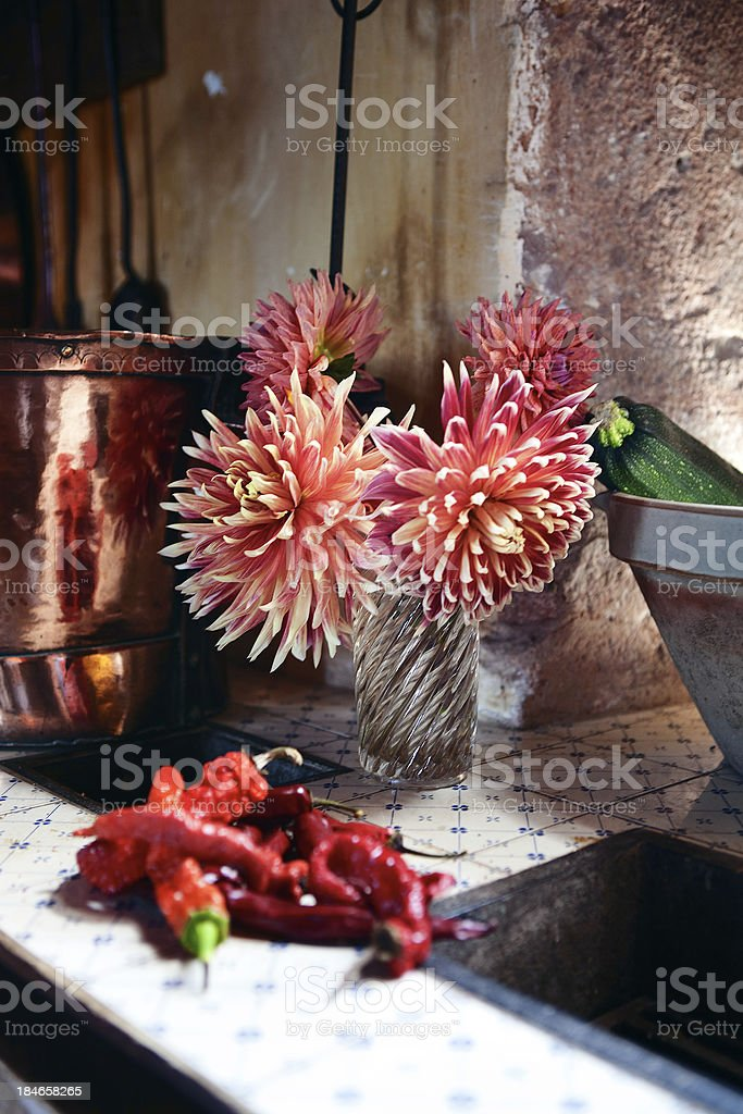 Flowers and chili peppers in the kitchen royalty-free stock photo