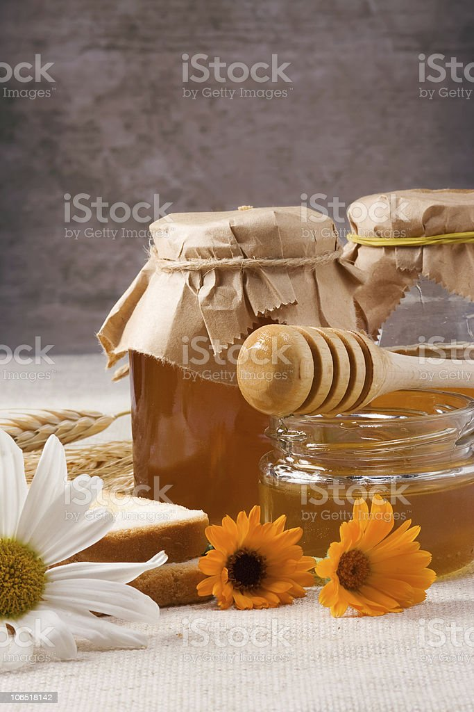 flowers and honey on table royalty-free stock photo
