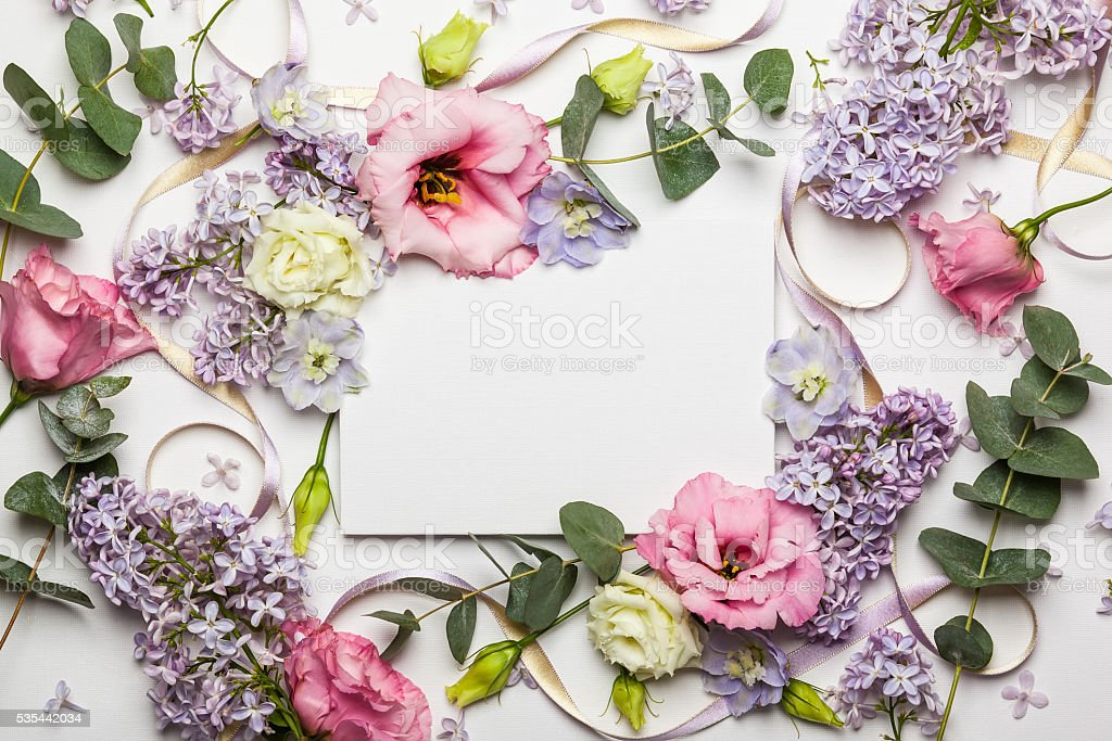 Flowers and invitation card stock photo