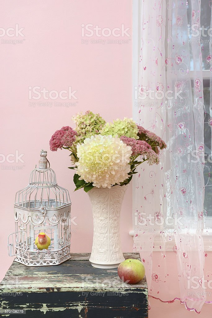 Flowers and Lovebird in a Pink Room stock photo