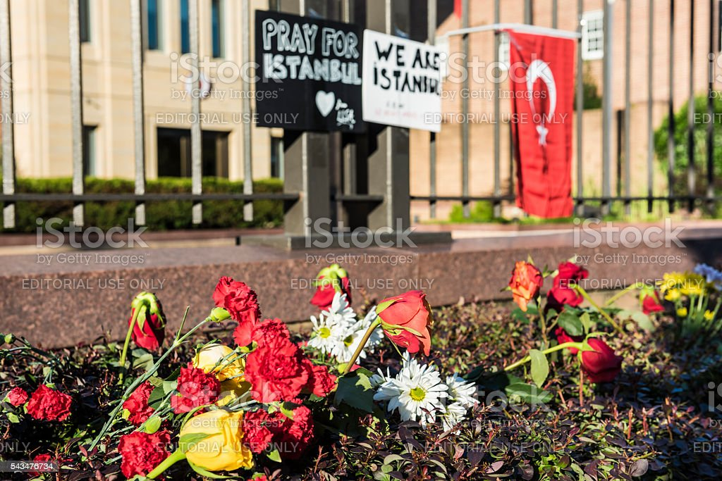 Flowers and posters at Turkish Embassy to commemorate Istanbul bombings stock photo