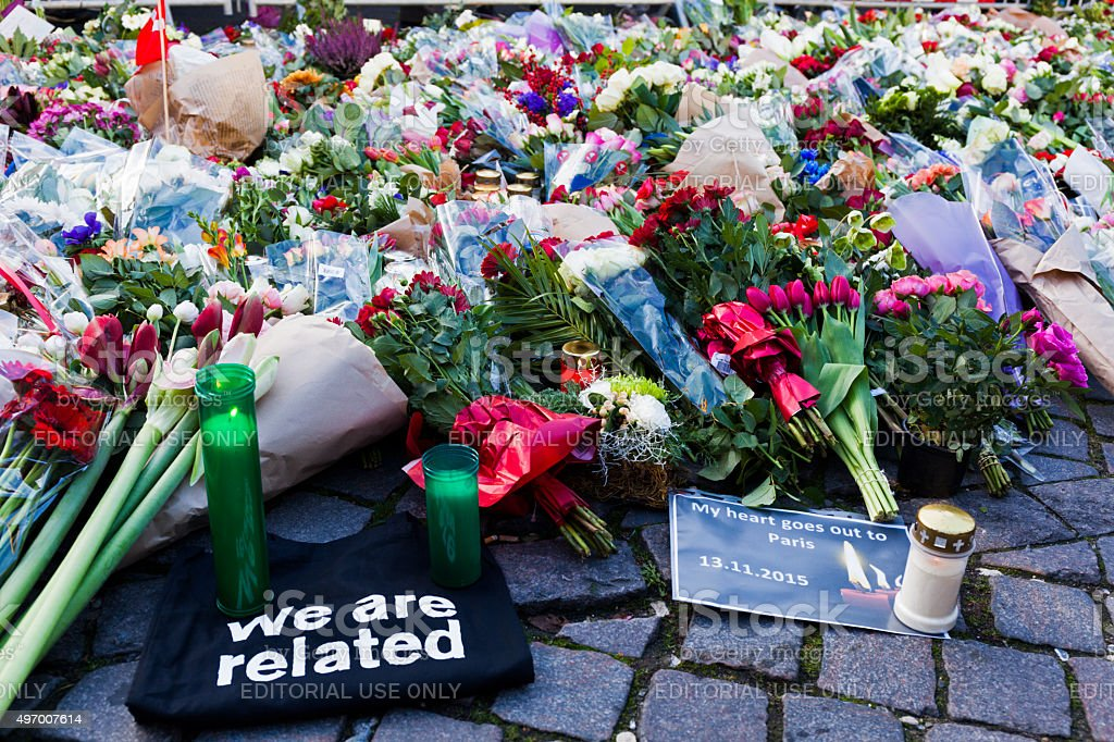 Flowers, candels and notes outside French Embassy after terror attack. stock photo