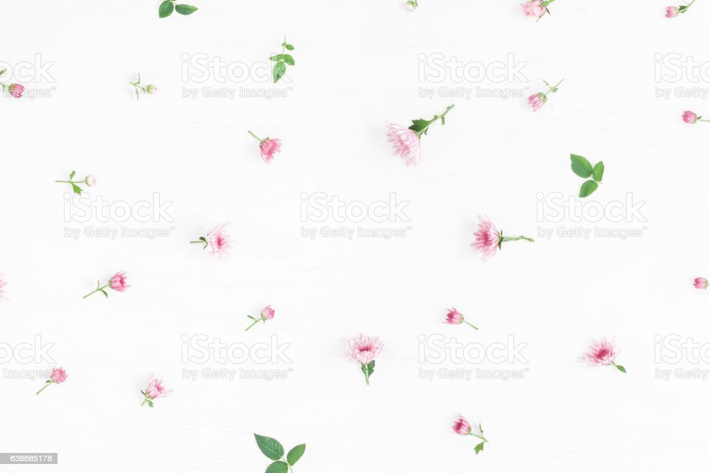 Flowers composition. Frame made of pink flowers and leaves.Flat lay stock photo