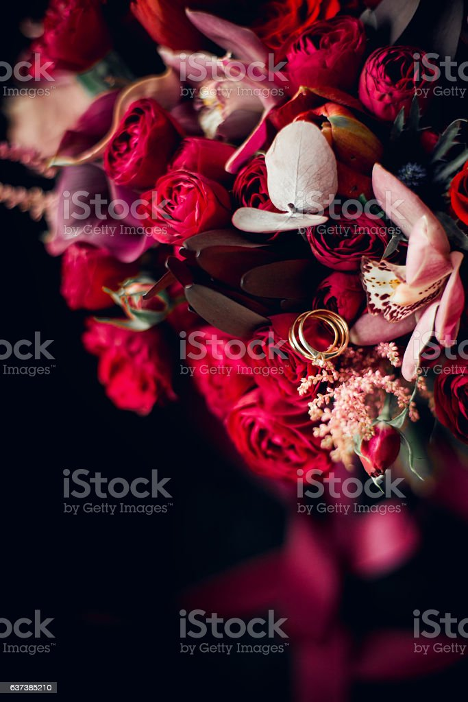 Flowers composition with wedding rings stock photo