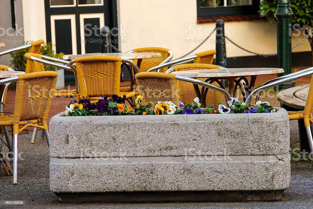 Flowers decorate outdoor caf?? in the Dutch town stock photo