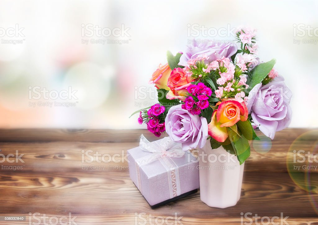 Flowers gift box on table empty space background. stock photo