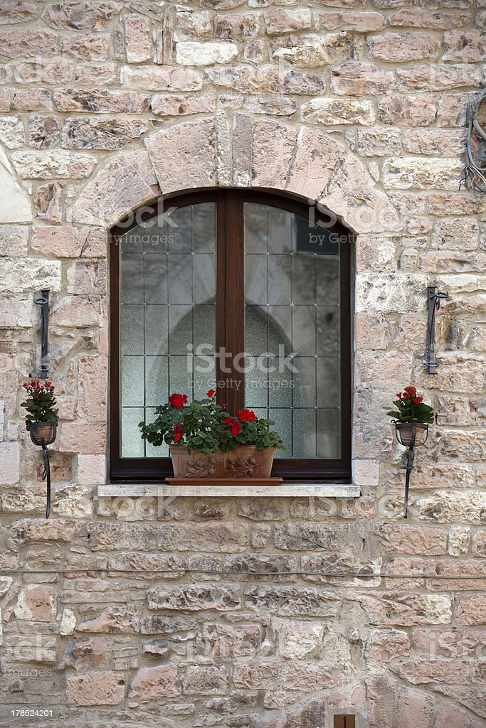 flowers hangs on the window royalty-free stock photo