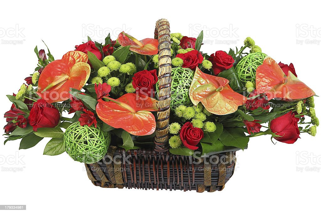 Flowers in a basket, red anthurium, chrysanthemum green, rose. royalty-free stock photo