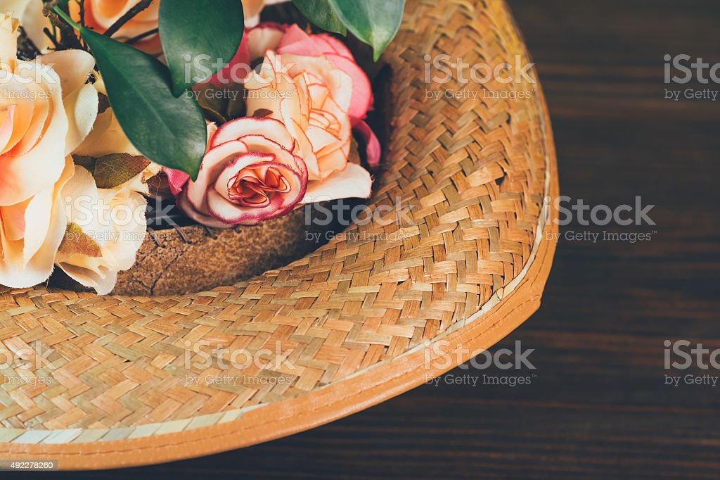 Flowers in a hat royalty-free stock photo