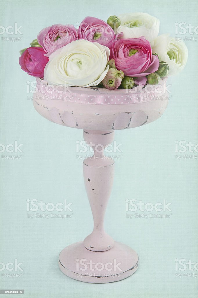 Flowers in an elegant pink tall vase royalty-free stock photo