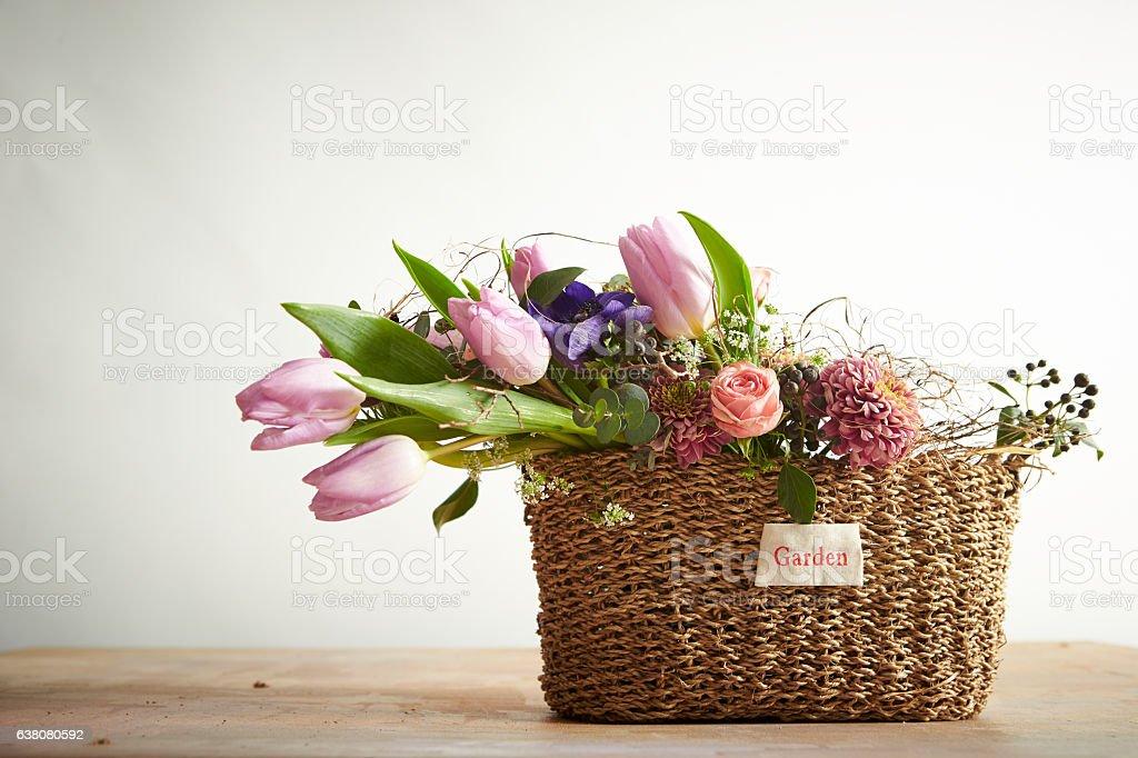 Flowers in basket stock photo