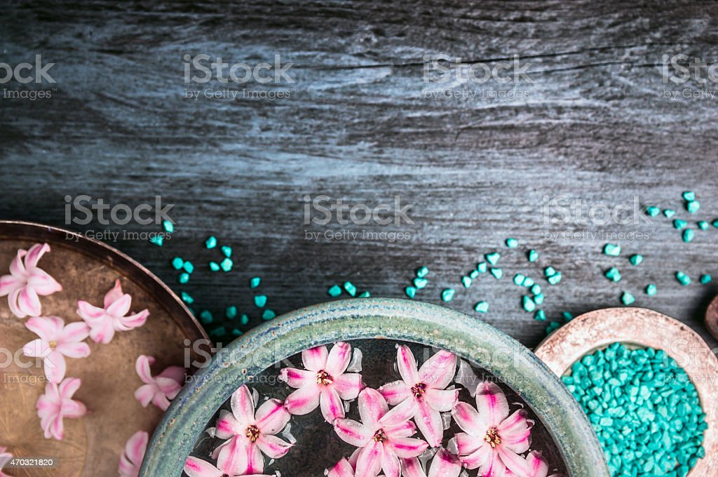flowers in bowls with water and  sea salt stock photo