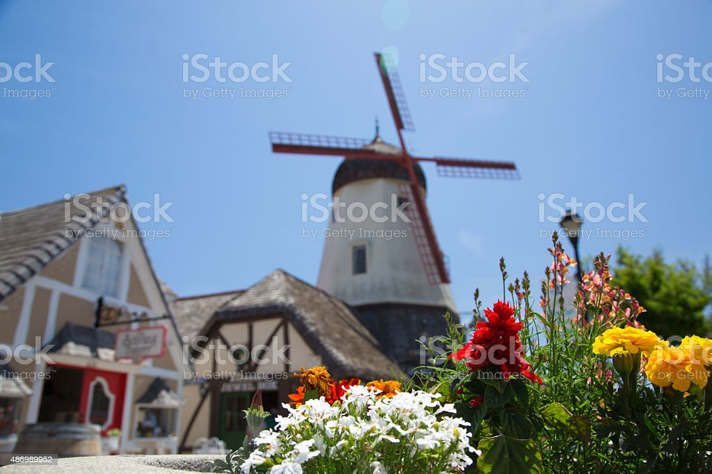 Flowers In Front of Solvang Windmill stock photo