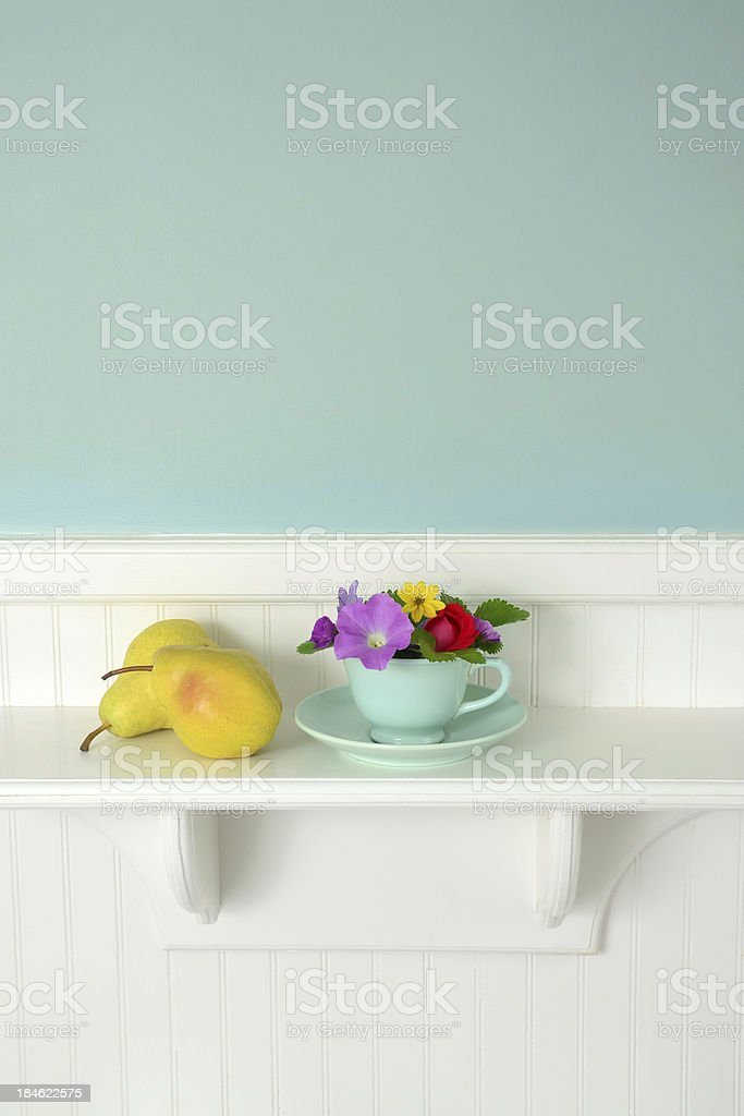Flowers in Teacup and Pears royalty-free stock photo