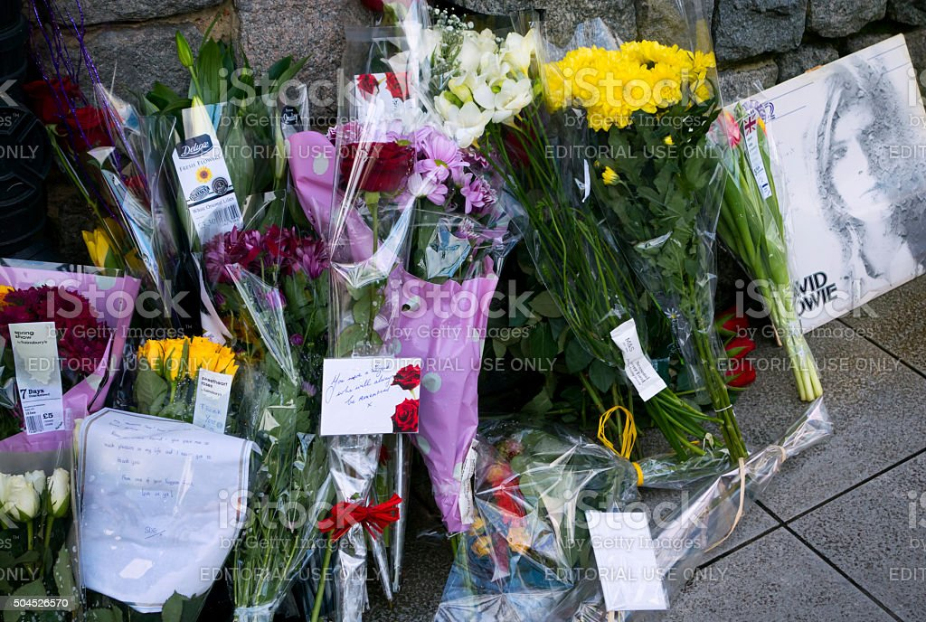 Flowers in tribute to David Bowie stock photo