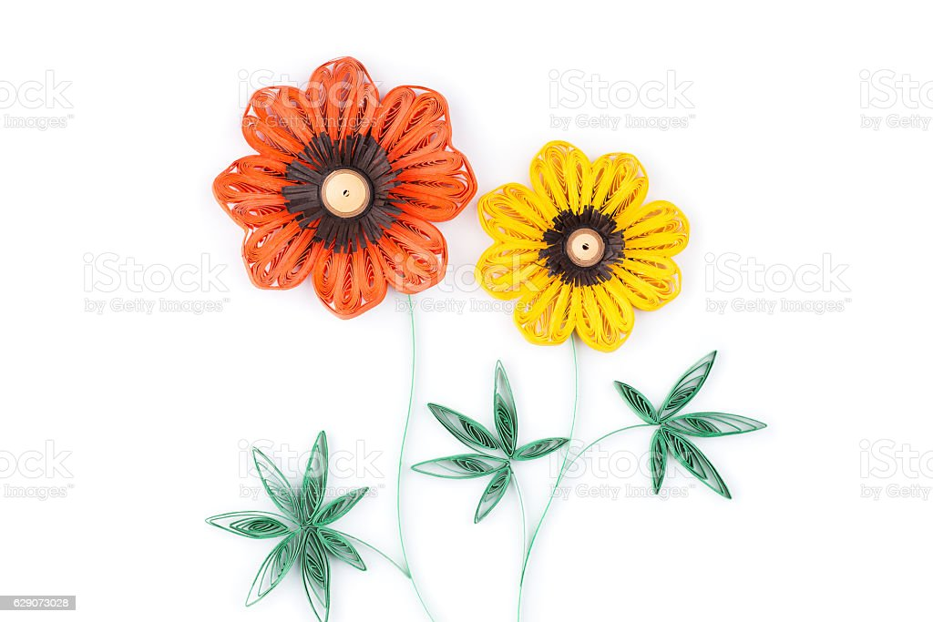 flowers made by quilling on a light background. stock photo
