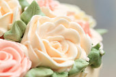 Flowers made from cream on wedding or birthday cake.
