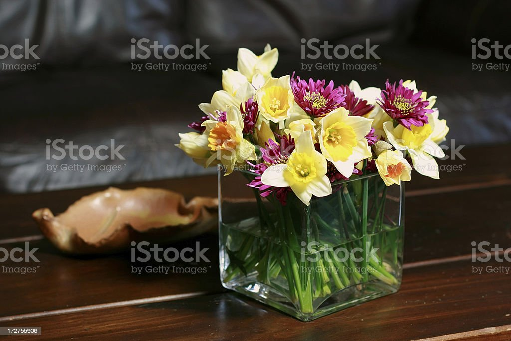 Flowers Mums and Dafodils in Square vase royalty-free stock photo