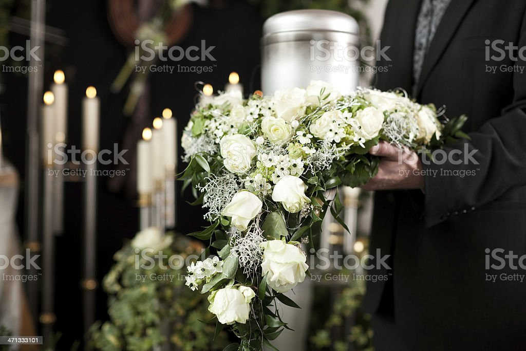 Flowers of grief at funeral and cemetery stock photo