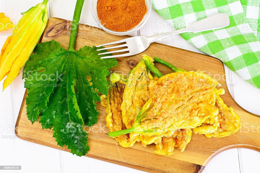 Flowers of Zucchini, Fried in Batter on a Wooden Background stock photo