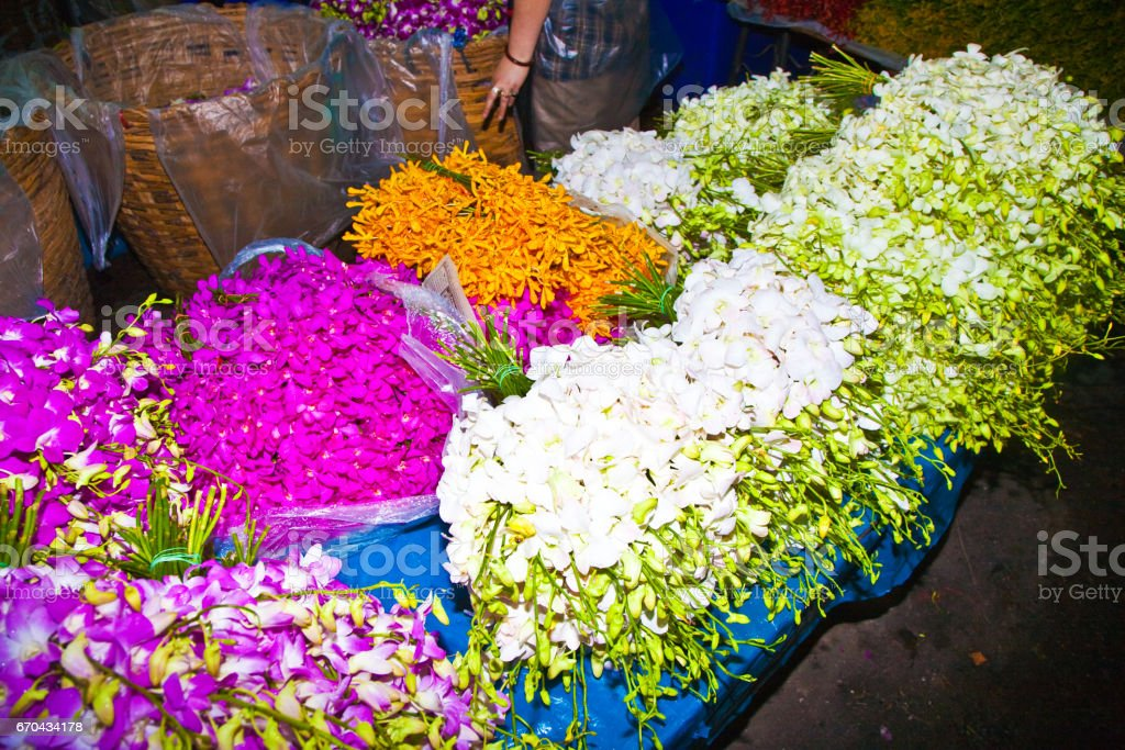 flowers offered at the flower market early morning stock photo