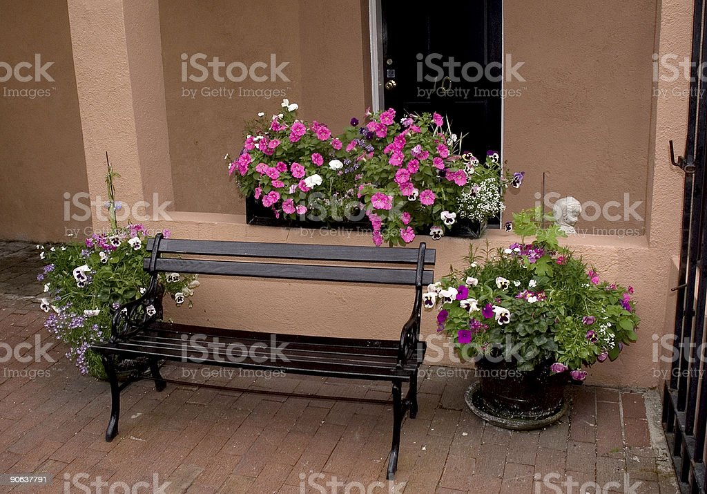 flowers on a black bench in Charleston royalty-free stock photo