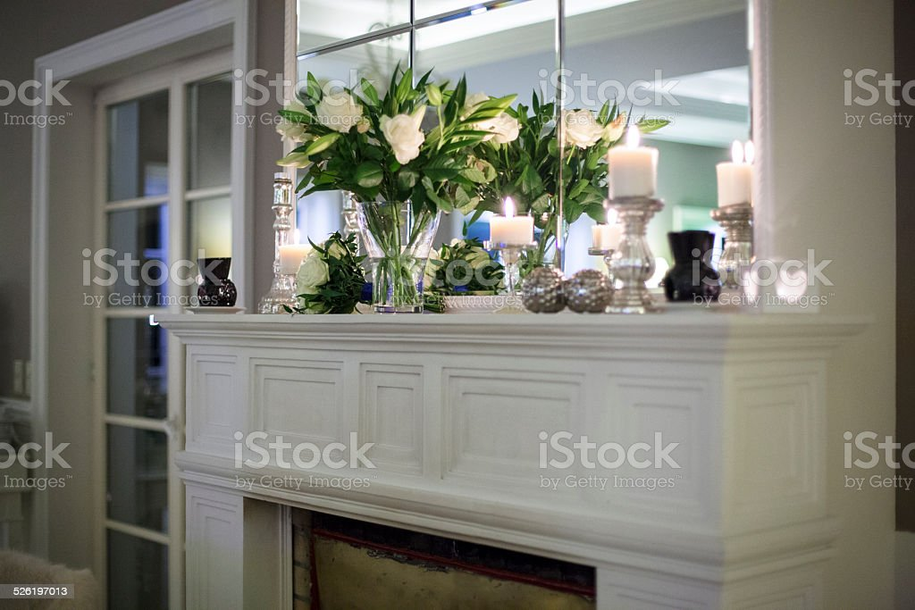 Flowers on a marble fireplace stock photo