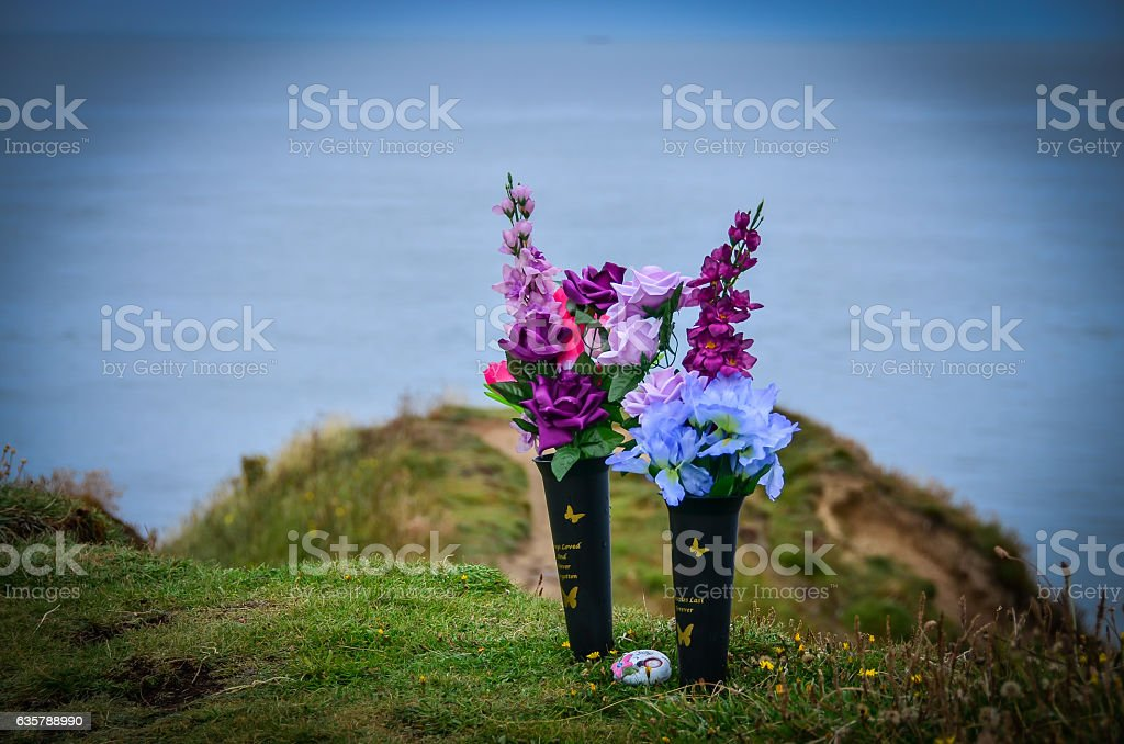Flowers on the sea shore in remembrance stock photo