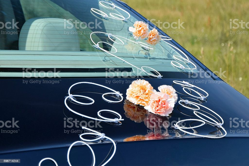 Flowers on the wedding car stock photo