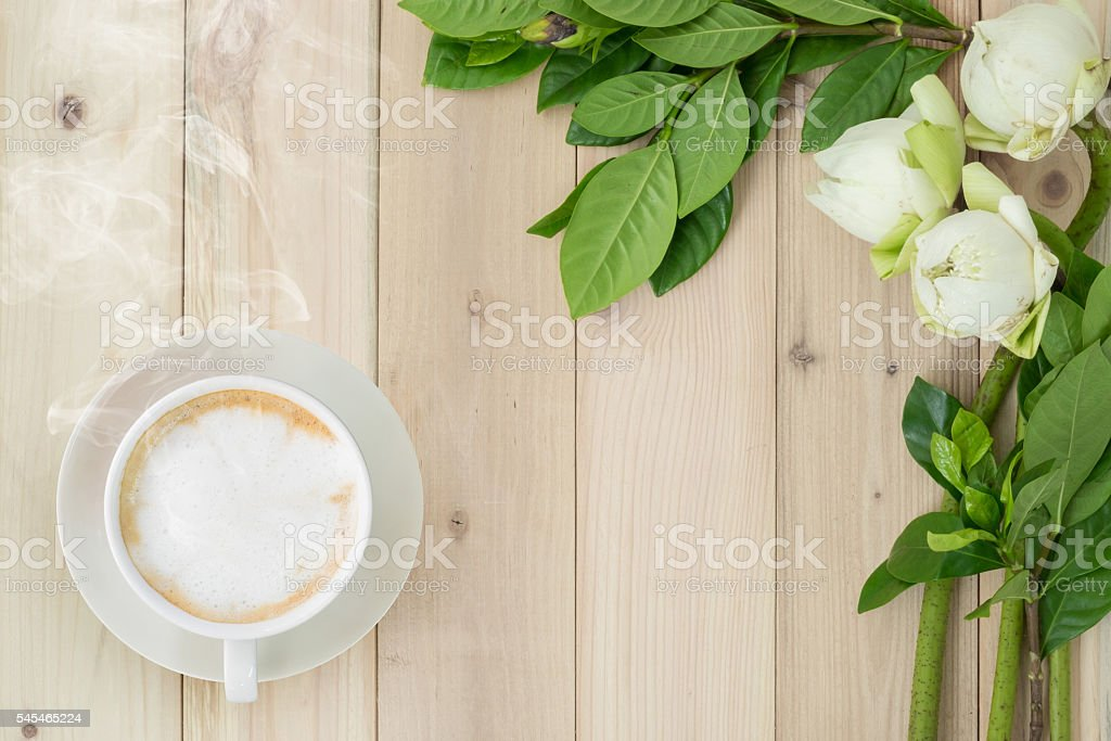 Flowers or lotus and redolent cappuccino coffee. stock photo