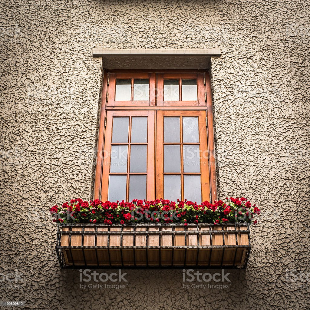 Flowers outside apartment window stock photo