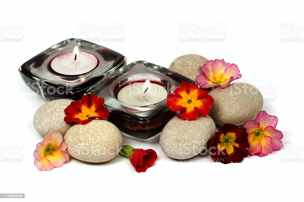 Flowers, stones and scented candles royalty-free stock photo