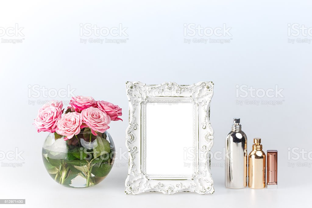 Flowers vase and vintage frame on white stock photo