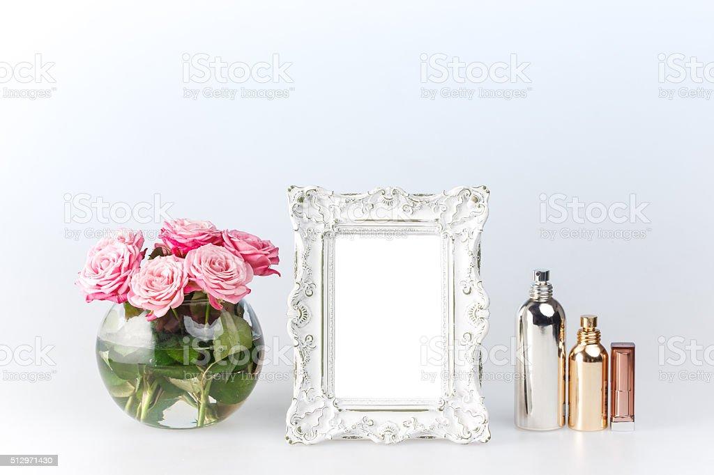 Flowers vase and vintage frame on white stock photo